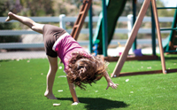 child_playing_on_artificial-grass