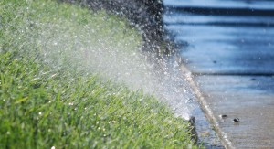 sprinkler watering natura grass which is not eco-friendly like artificial grass