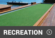 artificial turf used on a bocce ball court near water