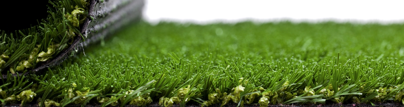 close image of rolling out artificial turf