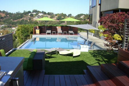 fake lawn around a pool