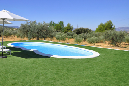 fake lawn used around a pool in a desert