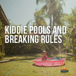 a child on a kiddie pool and how artificial grass eliminates the problem of putting a kiddie pool on natural grass.