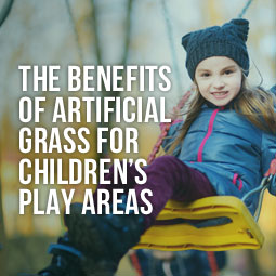 little girl swinging on swing in childrens play area and benefits of artificial grass