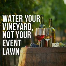 wine displayed on barrel at a vineyard event